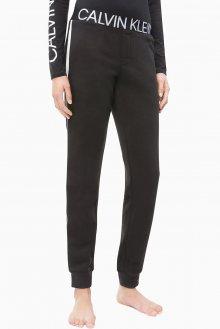Calvin Klein černé tepláky Jogger s proužkem - M