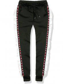 Khaki teplákové kalhoty s volánem