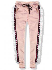 Meruňkové teplákové kalhoty s volánem